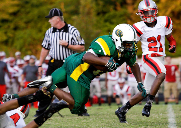 Jeffersonville defensive back Damin Smith trips up Floyd Central running back Garry Posey during the first quarter of their game at Floyd Central on Friday. Staff photo by Christopher Fryer