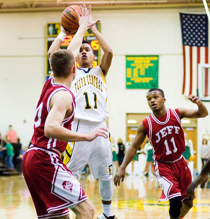 Floyd Central junior J.C. Kinnaird goes up for a shot during the Highlanders' home game against Jeffersonville on Friday. Floyd Central won the game, 71-70. Staff photo by Christopher Fryer