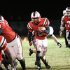 Jeffersonville running back Austin Hines found plenty of holes rushing for three touchdowns against New Albany in the first half Friday night. Staff photo by C.E. Branham
