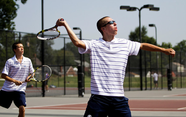 Providence freshman Ben Arnson prepares to return a shot during his No. 1 doubles match with junior Ryan Day against New Albany juniors Tanner Goller and Jake Kennard at the New Albany Boys' Tennis Invitational on Saturday. Staff photo by Christopher Fryer