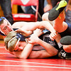New Washington sophomore Jacob Higbie wrestles Providence freshman Nick Tindall during their 126-pound match at the Jeffersonville Sectional on Saturday. Higbie pinned Tindall to win the match. Staff photo by Christopher Fryer