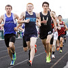 Runners compete in the 1600-meter run during the Floyd Central sectional track meet on Thursday. Staff photo by Christopher Fryer
