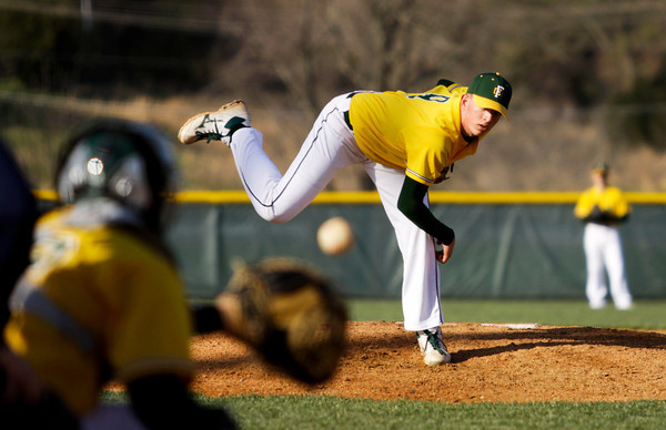 Floyd Central's Alex Koopman pitches during the Highlanders' home game against Borden on Thursday. Borden won the game, 8-7. Staff photo by Christopher Fryer