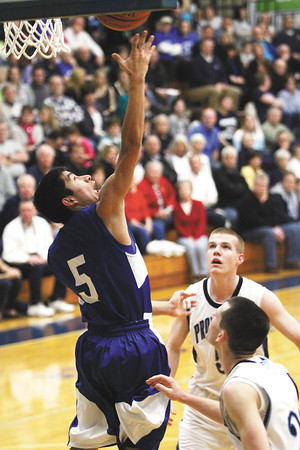 New Washington guard Adan Diaz puts up a reverse layup Friday night against Providence. Staff photo by C.E. Branham
