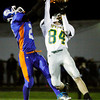 Defensive back Nick Wagner breaks up a pass intended for Gabe Clippert during Floyd Central's sectional championship game at Whiteland on Friday. The Highlanders lost the game, 41-20. Staff photo by Christopher Fryer