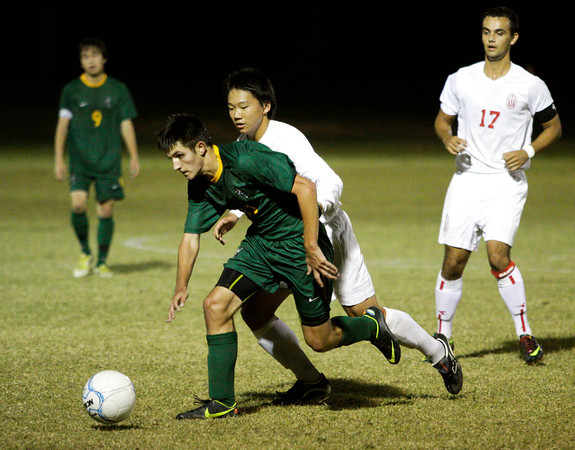 Jeffersonville senior Brian Fischer guards Floyd Central sophomore Parker Bussabarger during their game in the Indiana High School Athletic Association Boys Soccer Sectional tournament at Floyd Central on Wednesday. Jeffersonville won the game, 3-0. Staff photo by Christopher Fryer