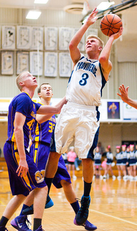 Providence guard Grant Goad goes up for a shot during the Pioneers' home game against Scottsburg on Saturday. Providence won the game, 51-43. Staff photo by Christopher Fryer