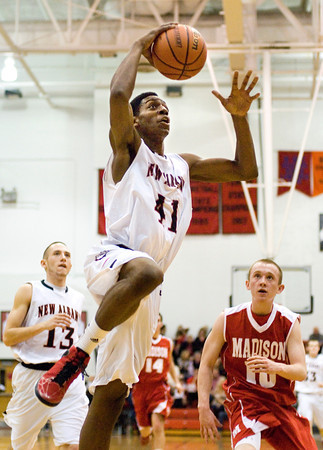 New Albany center Anthony Edwards goes up for a slam-dunk during their home game against Madison on Friday. Staff photo by Christopher Fryer