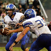 Charlestown senior Aaron Daniel hands off to senior Seth McCutchen during the first quarter of their away game against Corydon Central on Friday. Staff photo by Christopher Fryer