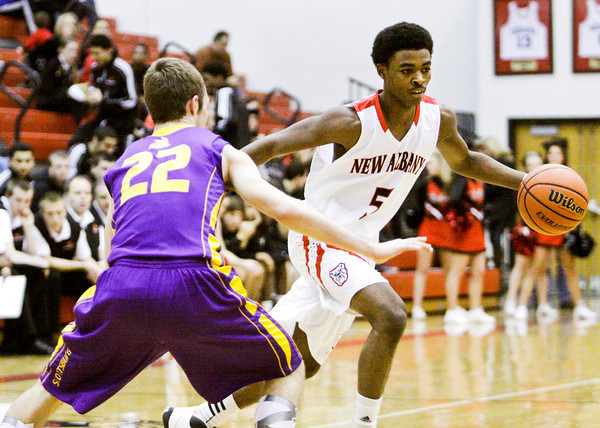 New Albany guard Davon Winburn moves the ball down court during the Bulldogs' home game against Scottsburg on Saturday. New Albany won the game, 77-59. Staff photo by Christopher Fryer