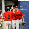 New Albany pitcher Brandon Johnson high-fives Tucker Marcum after he scored on an RBI single by Jack Shine during the fourth inning of their game at Providence on Thursday. Staff photo by Christopher Fryer