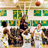 New Albany guard Leondre McBirth passes out of pressure during the Bulldogs' game at Floyd Central on Friday. New Albany won the game 49-45. Staff photo by Christopher Fryer