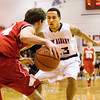 New Albany guard Jermaine Parrish covers Madison guard Nick Macon during their game in New Albany on Friday. Staff photo by Christopher Fryer