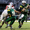 Floyd Central running back Garry Posey blocks for quarterback Bryce Smith in the backfield during their home game against Jeffersonville on Friday. Staff photo by Christopher Fryer