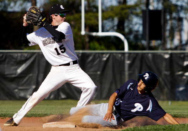 Providence's Jay Lorenz is forced out at second base by Clarksville's Cody Leonhardt during their game at Clarksville on Wednesday. Providence won the game in five innings, 13-0. Staff photo by Christopher Fryer