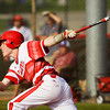 Jeffersonville senior Josh Burke connects for a three-run double during the Red Devils' 4-0 win over Jennings County at the New Albany Sectional on Wednesday. Staff photo by Christopher Fryer