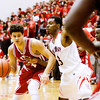 Jeffersonville senior Keenan Williams drives to the basket during the Red Devils' game at New Albany on Friday. New Albany won the game, 67-56. Staff photo by Christopher Fryer