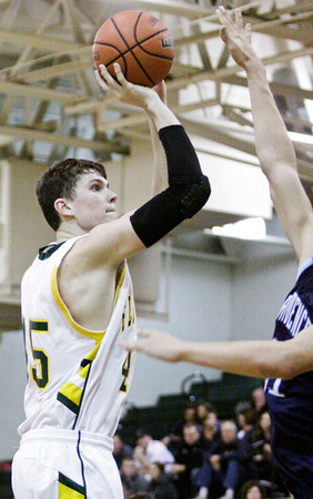 Floyd Central center Codie Hamsley goes up for a shot during their home game against Providence on Saturday. Providence won the game, 43-31. Staff photo by Christopher Fryer