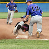 Silver Creek player Cody Razer is tagged out trying to steal third by Charlestown player Colin Martin in the championship game of the 3A sectional. Staff photo by C.E. Branham