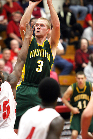 Floyd Central guard Drew Hussung drains a jumper at Jeffersonville Friday night. Staff photo by C.E. Branham