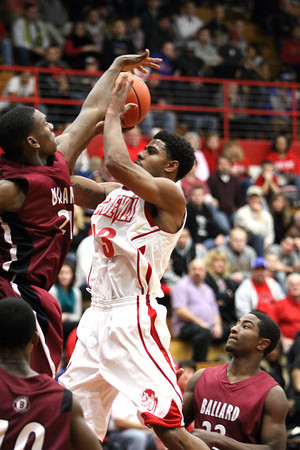 Jeffersonville guard Darryl Baker gets off a shot against Ballard Tuesday night. Jeff lost to the visiting Bruins 69-67. Staff photo by C.E. Branham