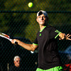 Floyd Central senior Ryan Plunkett moves to return the ball during his No. 1 singles match against Madison senior Kyle Sauley at Floyd Central on Monday. Staff photo by Christopher Fryer
