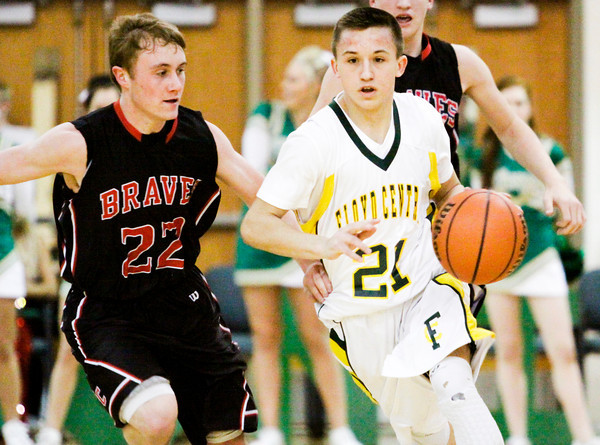 Floyd Central guard Cameron Simpson moves the ball downcourt during the Highlanders' home game against Brownstown Central on Tuesday. Staff photo by Christopher Fryer