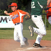 Silver Creek 10-11 All-Star second baseman Jake Jackson tries to beat a HYR runner to first base in District V play Monday night. The runner beat the play. Staff photo by C.E. Branham