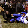 Charlestown senior Tyler Odle is brought down by Corydon Central senior Mitch Akers after receiving a pass during the second quarter of their game in Corydon on Friday. Staff photo by Christopher Fryer