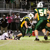 Floyd Central running back Nick Uhl drives the ball downfield during their home game against Seymour on Friday. Staff photo by Christopher Fryer