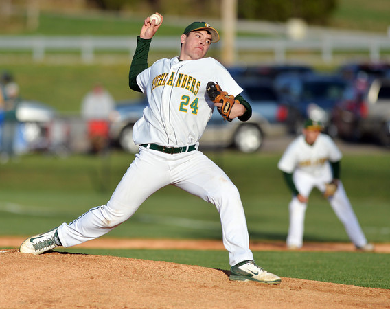 Highlander junior Brandon Smith pitches during Floyd Centrals' 12-4 victory over New Albany Wednesday evening.<br /> Staff photo by Tyler Stewart