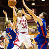 Jeffersonville senior Keenan Williams goes up for a shot during the Red Devils' game against Jennings County at the Seymour Sectional on Tuesday. Staff photo by Christopher Fryer