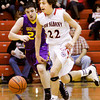New Albany guard Isaac Hibbard moves the ball down court during the Bulldogs' home game against Scottsburg on Saturday. New Albany won the game, 77-59. Staff photo by Christopher Fryer