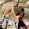 Providence center Daniel Schuler, left, and guard Ben Shahroudi battle for a rebound with New Albany forward DeAnthony Warren during their game at Providence on Friday. Staff photo by Christopher Fryer
