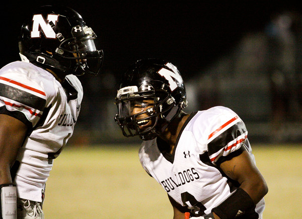 New Albany wide receiver Ravon Wright, right, celebrates with running back Tuwan Payton after scoring a touchdown at the end of the first half during their away game against Floyd Central on Friday. New Albany won the game, 28-27. Staff phtoo by Christopher Fryer