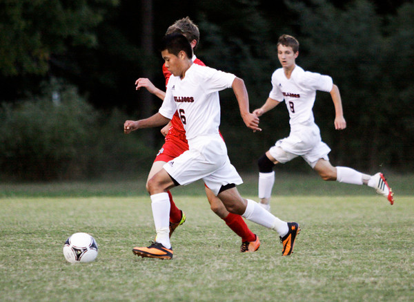 New Albany junior Christian Angeles moves the ball downfield during their home game against Jeffersonville on Tuesday. Jeffersonville won the game, 2-1. Staff photo by Christopher Fryer