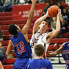 Indiana University Southeast sophomore Jake Simpson scores Wednesday night against Miami-Middletown. Staff photo by C.E. Branham