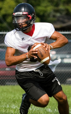 New Albany quarterback Zach Donan runs a play during their first practice of the season on Tuesday afternoon. Staff photo by Christopher Fryer
