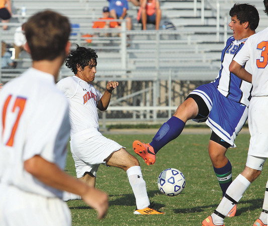 Silver creek player Alan Cruz, left, and Charlestown player Josh Waters battle for posession in a match Tuesday. Staff photo by C.E. Branham