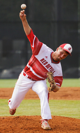 Jeffersonville senior Chandler Dale pitches during the Red Devils' 4-0 win over Jennings County at the New Albany Sectional on Wednesday. Staff photo by Christopher Fryer