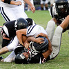 From left, New Albany's Jesse Demuth, Devin Higgins and Isaac Hipsher bring down Bedford North Lawrence quarterback Jesse Millikan in the first half of their game on Friday in New Albany. Staff photo by Christopher Fryer