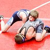Providence freshman Evan Rodgers wrestles Charlestown freshman Austin Weatherford during their 106-pound match at the Jeffersonville Sectional on Saturday.  Rodgers took the match in an 11-2 decision win over Weatherford. Staff photo by Christopher Fryer