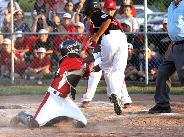 Jeff/GRC catcher Benny Day tags out New Albany All-Star Alexander Lozado in a run down between third and home Friday night. The Jeff/GRC 11-12 All-Stars won 4-2. Staff photo by C.E. Branham