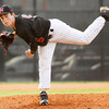New Albany's Tanner Goller pitches during the Bulldogs' 3-0 home win over Providence on Thursday. Staff photo by Christopher Fryer