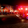 Fans wait outside as officials from the Clarksville Fire Department inspect the building after the fire alarm went off in the third quarter of Providence's game against South Central on Thursday night. It was a false alarm and play resumed after about 20 minutes. Staff photo by Christopher Fryer