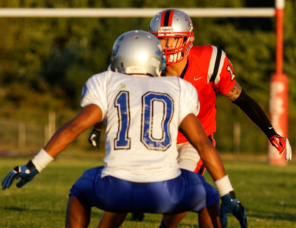 Jeffersonville High School wide receiver Ricky Embry faces off with Louisville Eastern High School's Clint Singleton during their game at Jeffersonville on Friday evening. Staff photo by Christopher Fryer