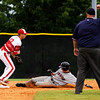 Jeffersonville senior Drew Ellis attempts a double play after forcing New Albany junior Eric Robison out at second base during the Red Devils' 7-1 victory over the Bulldogs in the championship game of the New Albany Sectional on Monday. Staff photo by Christopher Fryer