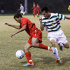 Jeffersonville defender Keenan Wilson protects the ball from Floyd Central midfielder Zach Lewis during the first half of their game at Floyd Central on Wednesday. Play was postponed due to weather with just over 15 minutes left in the first half and the score tied at one. The match will resume on Friday at Floyd Central. Staff photo by Christopher Fryer