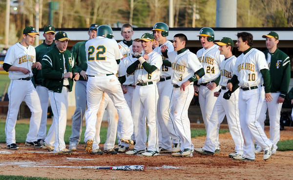Highlander junior Trey Fulton celebrates with teammates after hitting a home run during Floyd Centrals' 12-4 victory over New Albany Wednesday evening.<br /> Staff photo by Tyler Stewart
