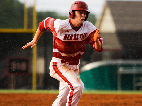 Jeffersonville sophomore Ian Ellis rounds third base on his way to score during the Red Devils' 4-0 win over Jennings County at the New Albany Sectional on Wednesday. Staff photo by Christopher Fryer